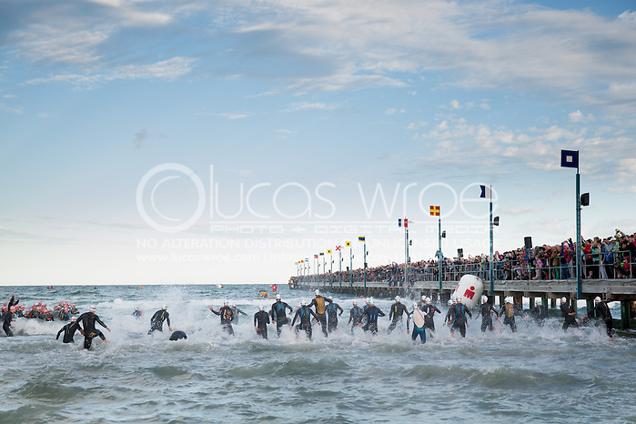Pro Men Enter The Water At The Swim Start. Ironman Asia Pacific Championship Melbourne. Triathlon. Frankston And St Kilda, Melbourne, Victoria, Australia. 24/03/2013. Photo By Lucas Wroe (Lucas Wroe)