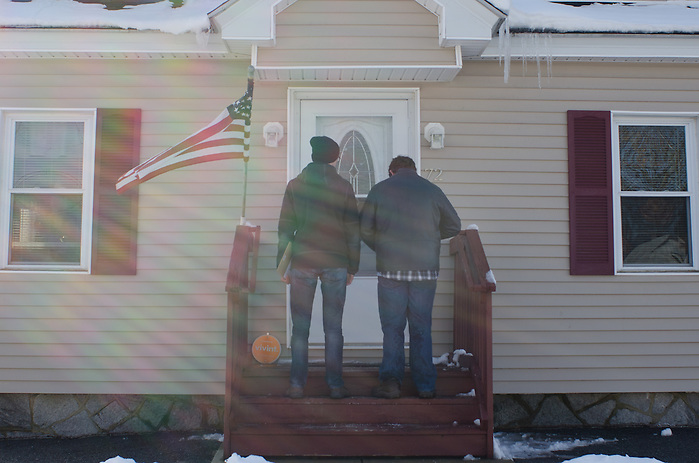 2016-02-06-Manchester, NH-Members of Tufts for Bernie canvass in Manchester, NH on Sunday February 6th before the state primary on Tuesday. Nate Krinsky (left) and Zach Bernstein (right) wait for a Manchester resident to open their door (Alex Knapp / The Tufts Daily) (Alex Knapp)