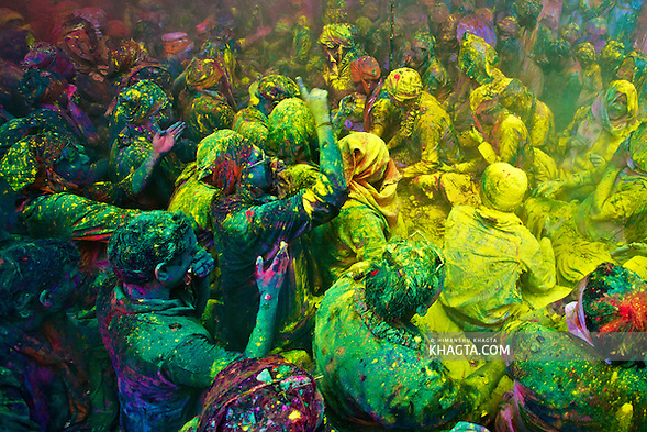 People of Braj Region of Mathura, celebrating,Holi, 'the festival of colors' in Barsana Village of India. People sit together and sing and abuse each other in braj language while others throw colored powder and water on them. (Himanshu Khagta)