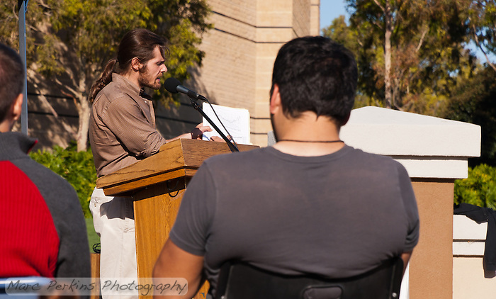 Dan Wolfe speaks and points to a data graph at the Occupy Orange County, Irvine camp on November 5. (Marc C. Perkins)