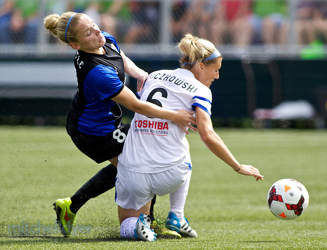 TUKWILA, WA - AUGUST 31: Kim Little #8 of Seattle Reign FC and Jen Bucowski #6 of FC Kansas City collide in the first half of of the National Women's Soccer League Championship on August 31, 2014 at Starfire Stadium in Tukwila, Washington.  (Photo by Craig Mitchelldyer/Getty Images) *** Local Caption *** Kim Little; Jen Bucowski (Craig Mitchelldyer/Getty Images)