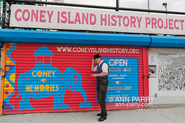 Brooklyn, New York, USA. 10th August 2013. BOB STUHMER, a member of AMICA, poses under the Coney Island History Project banner over the booth where visitors can get information about world famous neighborhood, beach and boardwalk and amusement park, during 3rd Annual Coney Island History Day celebration. (© 2013Ann Parry/Ann Parry, ann-parry.com)