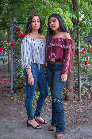 Calistoga high school students Vitoria Montanez and Jasmin Romero wait outside the Quinceanera celebration at the Napa Fairgrounds in Calistoga.  hernandez_kari12@yahoo.com (Clark James Mishler)