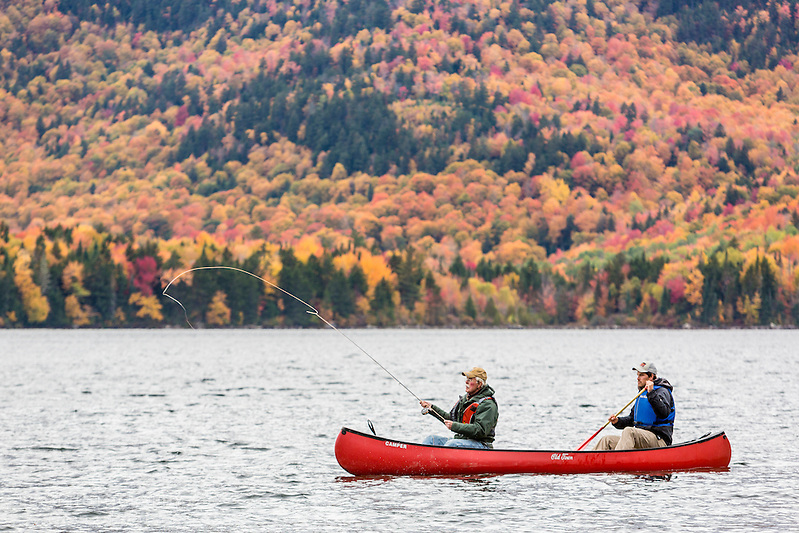 Two men fly fishing from a canoe on Greenough Pond in Wentworths Location, New Hampshire. Fall. Northern Forest. (Jerry and Marcy Monkman)