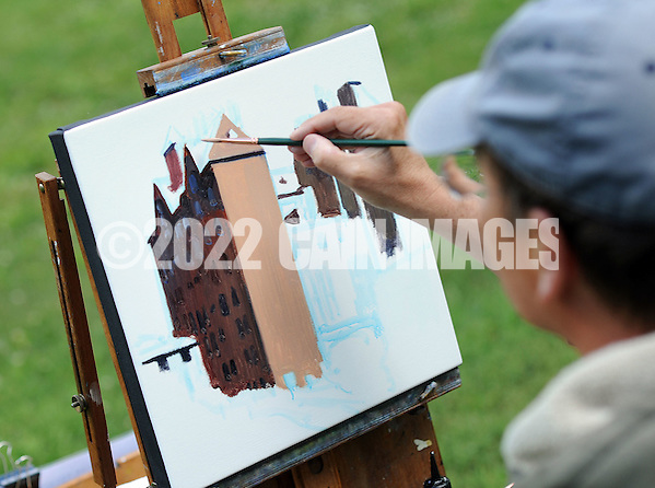 "Artist John Schmidtberger paints a picture during the first ever Bucks County Plein Air Festival Wednesday June 8, 2016 at the Mercer Museum in Doylestown, Pennsylvania. The competitively-selected artists will paint outdoors ""en plein air"" or ""in open air"" over the course of three days in various locations throughout the county to create various landscapes and streetscapes. (Photo by William Thomas Cain) (William Thomas Cain)"