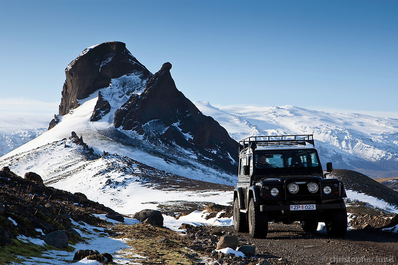 A Land Rover Defender by mountain Einhyrningur. Glacier Eyjafjallajokull in background. ©2009 Christopher Lund.