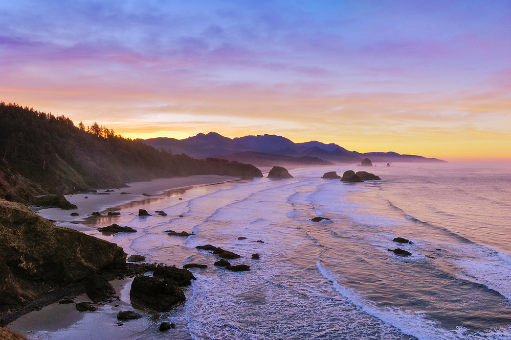 View of Crescent Beach, Cannon Beach, Haystack Rock and coast to Hug Point from Ecola State Park at sunrise; Oregon. (Greg Vaughn/© Greg Vaughn)