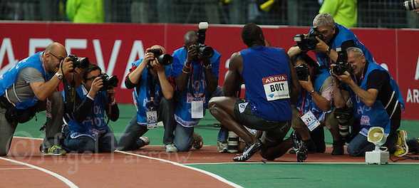 08 JUL 2011 - PARIS, FRA - Usain Bolt poses for photographers after winning the men's 200m race at the Meeting Areva round of the Samsung Diamond League (PHOTO (C) NIGEL FARROW) (NIGEL FARROW/(C) 2011 NIGEL FARROW)