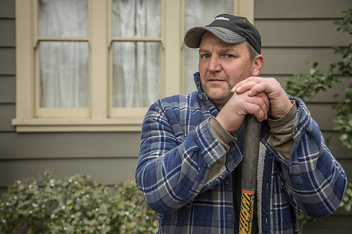 """I do maintenance for some of the smaller wineries...those who may not have a maintenance department.  Carpentry, welding, electrical...I do what ever is required.""  -Mike McKay replaces posts at a home on Cedar Street in Calistoga. (© 2017 Clark James Mishler)"