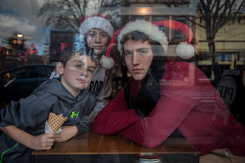 High School student, Dom, with his brother and sister at Starbucks in downtown Petaluma, CA (© Clark James Mishler)