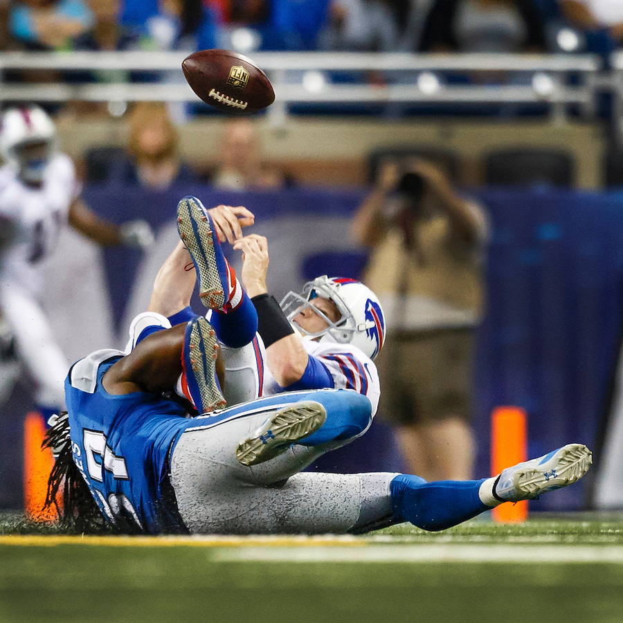 Detroit Lions linebacker Josh Bynes (57) cause Buffalo Bills quarterback Matt Simms (8) to fumble during an preseason NFL football game at Ford Field in Detroit, Thursday, Sept. 3, 2015. (AP Photo/Rick Osentoski) (Rick Osentoski/AP)