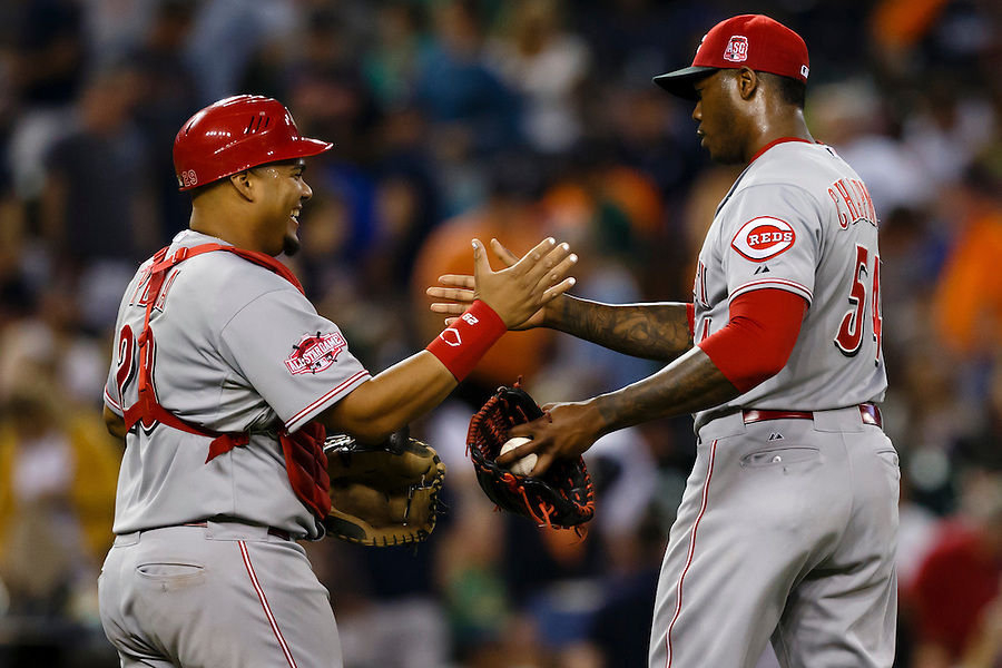 Jun 16, 2015; Detroit, MI, USA; Cincinnati Reds catcher Brayan Pena (29) and relief pitcher Aroldis Chapman (54) celebrate after the game against the Detroit Tigers at Comerica Park. Cincinnati won 5-2. Mandatory Credit: Rick Osentoski-USA TODAY Sports (Rick Osentoski/Rick Osentoski-USA TODAY Sports)