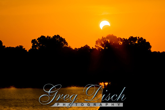 Eclipse at sunset  on the Arkansas River in eastern Oklahoma May 20, 2012. (Greg Disch)