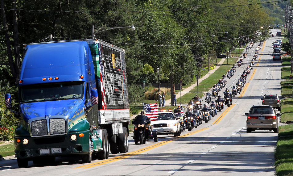 The Dignity Memorial Vietnam Wall --- a traveling, three-quarter-scale replica of the Vietnam Veterans Memorial in Washington, D.C., arrives in a semi with a motorcycle escort in West Des Moines on Sept14, 2011.  The traveling memorial will be open to school children on Thursday and be open to the public at Resthaven Cemetery in West Des Moines from Friday to Sunday. The faux-granite replica is 240 feet long, eight feet high and contains the names of more than 58,000 Americans who died or are missing in Vietnam. More than 30,000 people are expected to see the display while it is in West Des Moines.  (Christopher Gannon/The Des Moines Register) (Christopher Gannon/The Register)