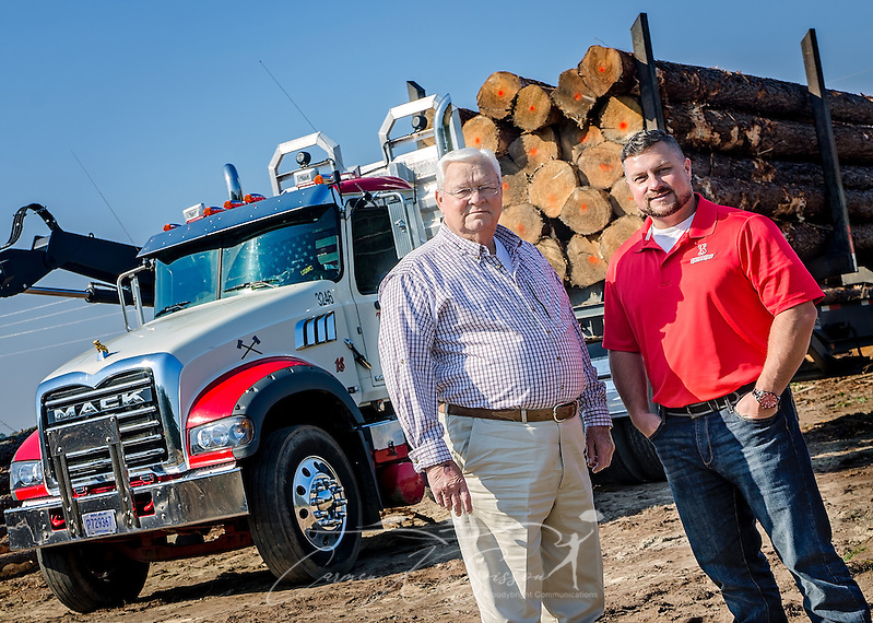Tracy Gunter Jr. and his son, Tracy Gunter III, stand on a job site with one of the Mack Granites they use in their logging business, Nov. 16, 2016, in Steadham, S.C. The men own and operate Tracy's Logging and T3 Chipping, where they oversee four logging crews and two chpping crews, averaging 300 loads per week. (Photo by Carmen K. Sisson) (Carmen K. Sisson/Cloudybright)