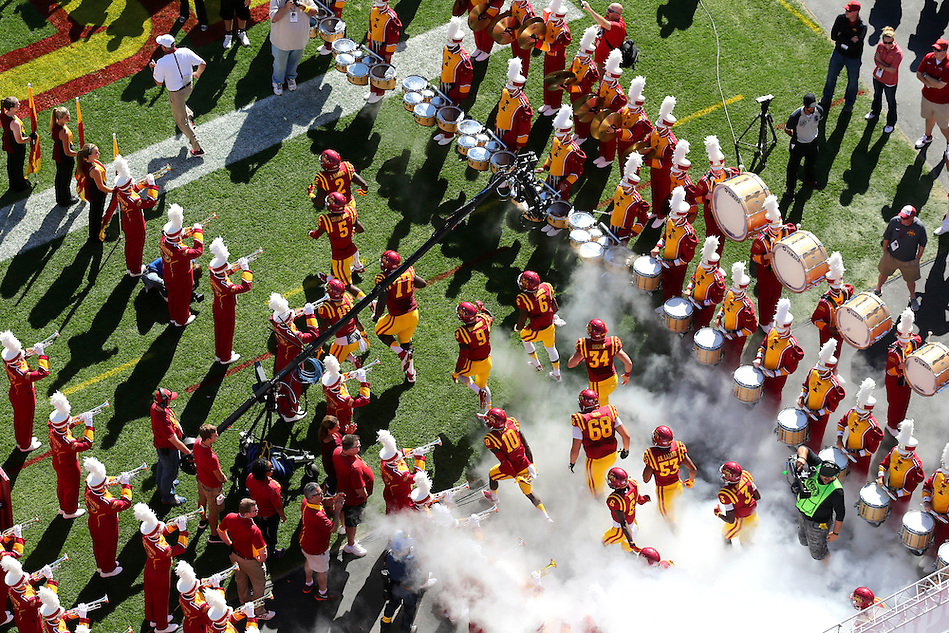 Head coach Paul Rhoads leads the cyclones onto the field before Iowa State's game against Iowa on Sept 12, 2015. (Photo by Christopher Gannon/Iowa State University) (Christopher Gannon)