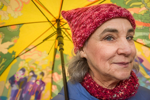 Joan Temple joins with the women of Calistoga as they march on a rainy day to demonstrate their opposition to President Trump and his anti-women policies. (Clark James Mishler)