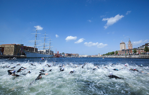 22 MAY 2011 - DUNKERQUE, FRA - Competitors make their way up the dock at the start of the Triathlon de Dunkerque .(PHOTO (C) NIGEL FARROW) (NIGEL FARROW/(C) 2011 NIGEL FARROW)