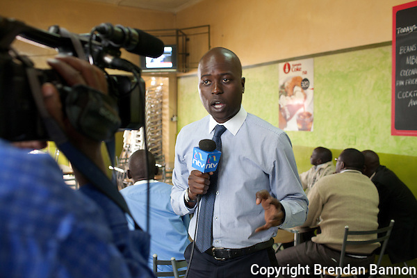 NTV reporter Robert Nagila reporting on the public reaction to Kenyan leaders' appearance at the International Criminal Court on charges related to  the 2007 post-election violence. (Brendan Bannon)