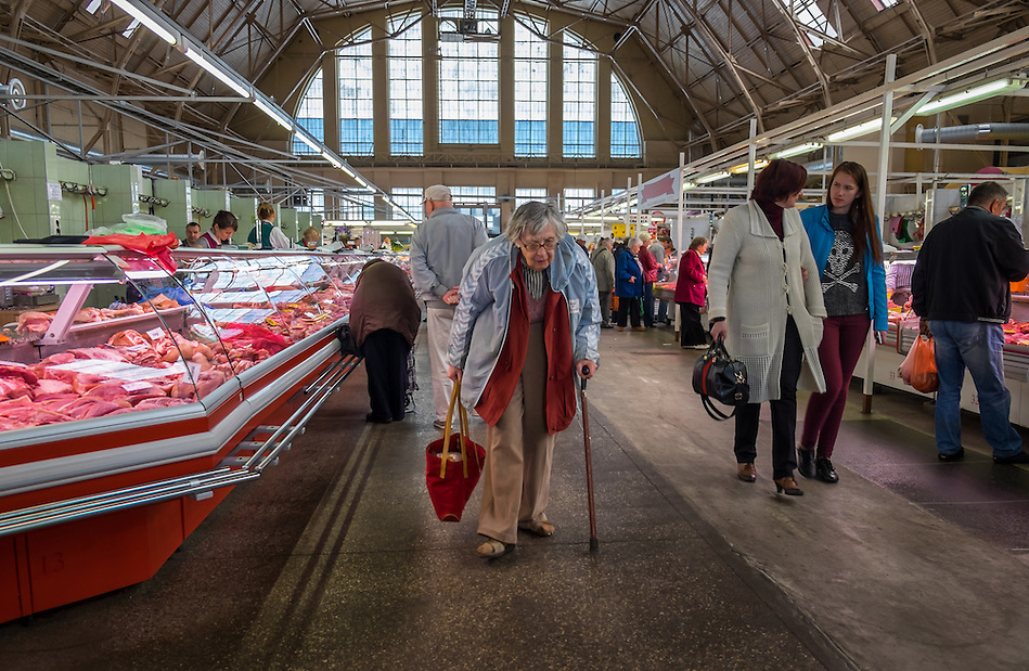 RIGA, LATVIA - CIRCA MAY 2014: Old woman walking in Riga Central Market (Daniel Korzeniewski)