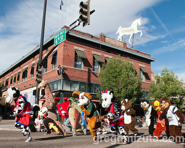 The start of the Mascot Scamper during the Main Street Mile sponsored by Saint Alphonsus in downtown Boise, Idaho on June 22, 2012. Fourteen mascots participated in the event with Bessie the Cow (powered by Dusty Black) winning the spectator popular race. Proceeds from the Main Street Mile are used to promote prostate cancer awareness and education and to provide free screenings to men in the Treasure Valley. (Gregg Mizuta)