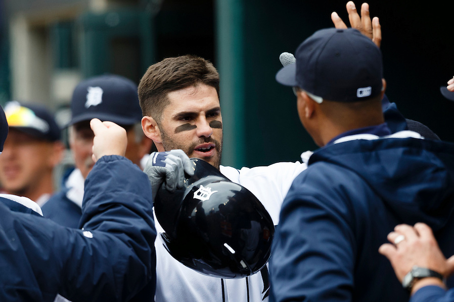 Apr 6, 2015; Detroit, MI, USA; Detroit Tigers left fielder J.D. Martinez (28) receives congratulations from teammates after he hits a home run in the second inning against the Minnesota Twins at Comerica Park. Mandatory Credit: Rick Osentoski-USA TODAY Sports (Rick Osentoski/Rick Osentoski-USA TODAY Sports)