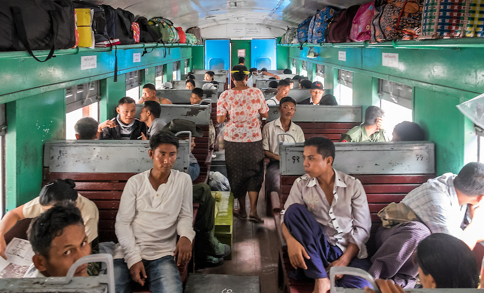 YANGON, MYANMAR - CIRCA DECEMBER 2013:  People inside a typical wagon of the Yangon circular railway service, awaits to depart from Yangon Central Railway Station (Daniel Korzeniewski)