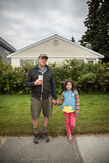 "Retired teacher Jonathan Halpern with his seven year old daughter, Naomi, in Anchorage's South Addition neighborhood.  ""We just stopped at Fire Island Bakery...we had chocolate cookies right out of the oven.""  halpernjs@hotmail.com (© Clark James Mishler)"