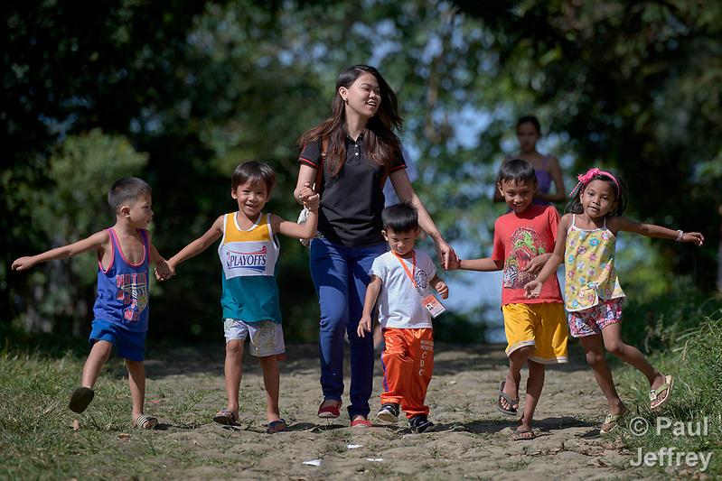 Deaconess Maria Jessica Cicillo walks with a group of children in Mt. Heights, Philippines, where she works as a Christian educator for a nearby United Methodist Church. She is a graduate of Harris Memorial College. (Paul Jeffrey)