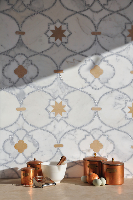 Vittoria, waterjet and hand cut mosaic shown in Lagos Gold honed, Calacatta Tia and Allure polished is part of the Miraflores Collection by Paul Schatz for New Ravenna Mosaics. (New Ravenna Mosaics 2013)