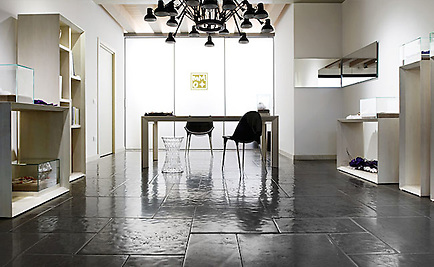 Solid Natural Limestone Tiles of a very consistent composition, with straight cut, slightly pillowed edge, naturally undulated, high honed surface. Available in a very homogeneous Grey and in a highly variegated Beige. Please call for color and size availability. (New Ravenna Mosaics)
