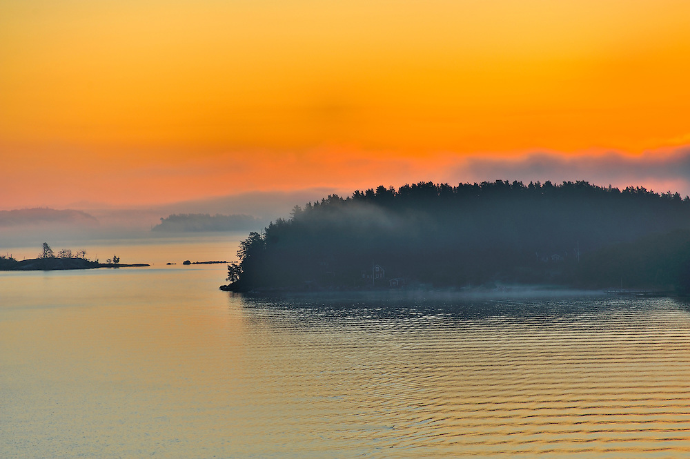 The Stockholm Archipelago along the Swedish coastline seen from the Baltic Sea at sunrise. Cottages are just visible in the fog. (Note: Photo taken around 5:19 AM August 19, 2011 - camera time set incorrectly - camera 7 hours early). (Marianne Campolongo/© Marianne A. Campolongo)