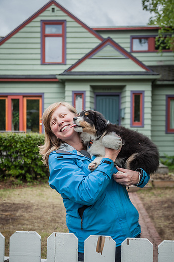 Neighbor Nancy Martin with her ten month old Auzie, Puck.  martin@acsalaska.net (© Clark James Mishler)