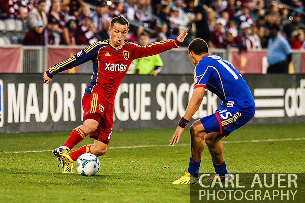 April 6th, 2013 - Real Salt Lake midfielder Luis Gil (21) attempts to get past Colorado Rapids defender Chris Klute (15) in second half action of the MLS match between Real Salt Lake and the Colorado Rapids at Dick's Sporting Goods Park in Commerce City, CO (Carl Auer/Newsport)