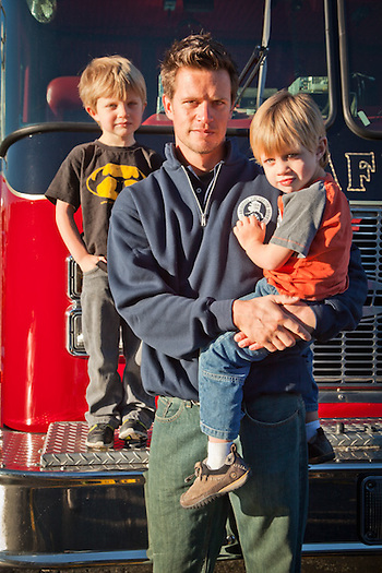 Anchorage Firefighter, Eric Lawson, with his sons, Nathan and Aiden, at union headquarters in south Anchorage. (Clark James Mishler)