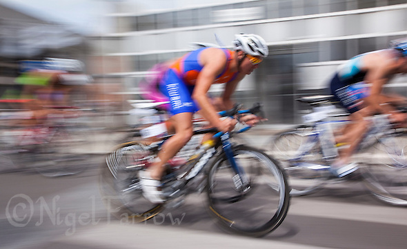 22 MAY 2011 - DUNKERQUE, FRA - Competitors race through the streets of Dunkerque during the men&#039;s round of the 2011 French Grand Prix triathlon series (PHOTO (C) NIGEL FARROW) (NIGEL FARROW/(C) 2011 NIGEL FARROW)