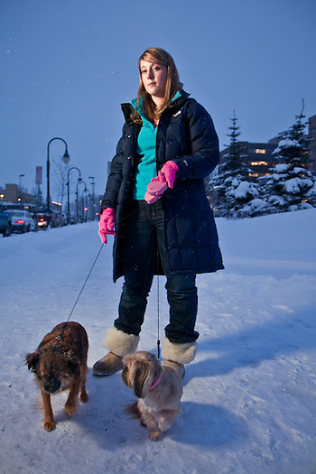 "Jayme Keller with her dogs, Daphne and Sophie, in front of State of Alaska Court House, downtown, Anchorage.  ""Daphne and Sophie refused to go outside because of the deep snow, so I brought them downtown because I knew it would be cleared."" (Clark James Mishler)"