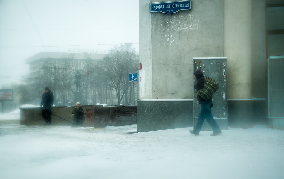 MOSCOW - CIRCA MARCH 2013: Snow storm in the streets of Moscow with people in the streets, circa 2013. With a population of more than 11 million people is one the largest cities in the world and a popular tourist destination. (Daniel Korzeniewski)