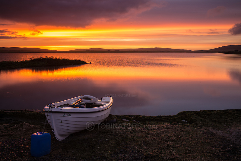 The sun rises over the Loch of Harray on Orkney, Scotland. (Andrew Tobin)
