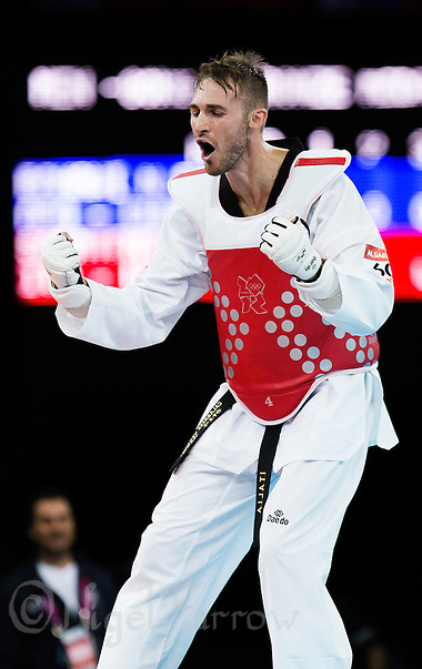 10 AUG 2012 - LONDON, GBR - Mauro Sarmiento (ITA) of Italy celebrates winning the men's -80kg category bronze medal B contest against Nesar Bahawi of Afghanistan at the London 2012 Olympic Games Taekwondo at Excel in London, Great Britain .(PHOTO (C) 2012 NIGEL FARROW) (NIGEL FARROW/(C) 2012 NIGEL FARROW)