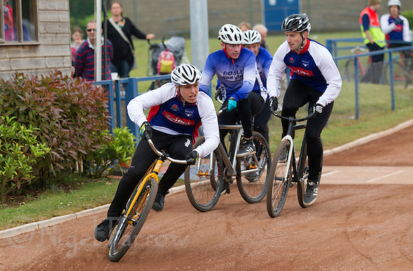 14 JUN 2015 - IPSWICH, GBR - Pierce Bacon (left) of Ipswich Eagles breaks away as his team mate Adam Peck (right) holds off Dean Hook and Pete Chant of Poole Comets as they enter the first bend during their Elite League cycle speedway fixture at Whitton Sports and Community Centre in Ipswich, Suffolk, Great Britain (PHOTO COPYRIGHT © 2015 NIGEL FARROW, ALL RIGHTS RESERVED) (NIGEL FARROW/COPYRIGHT © 2015 NIGEL FARROW : www.nigelfarrow.com)