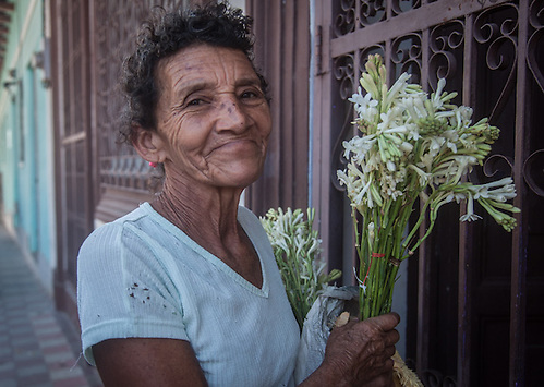 Woman selling flowers in Granada, Nicaragua, Central America (Clark James Mishler)