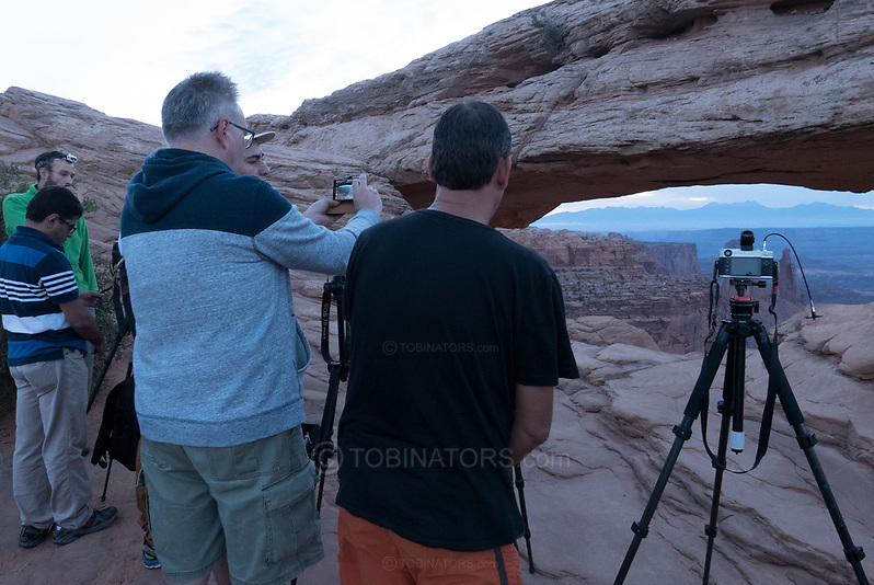 Photographers gather for dawn at Mesa Arch, Utah. Picture by Andrew Tobin. (Andrew Tobin)