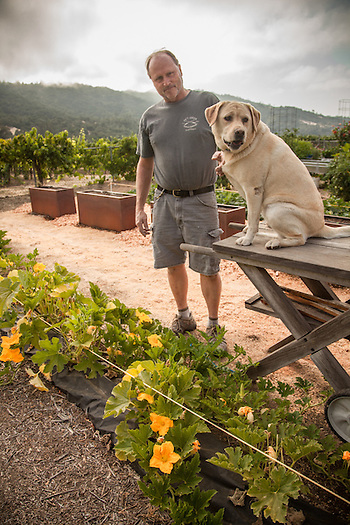 Cabinet maker Ray Smith in his garden with his dog, Kiah, in Cloverdale, CA. (Clark James Mishler)