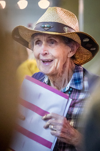 Ellie Leake clutches her Bingo cards as she searches for a seat at the Community Bingo event sponsored by the Fire Firghter's Community Bingo event.  Money was raised for victums of recent wild fires in Sonoma and Napa Counties.  The event was held at the Tubbs Building in Calistoga. (Clark James Mishler)