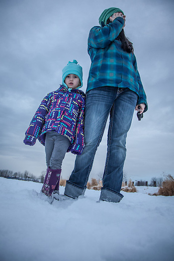 "Dana Billman with her dauther, Tatum, at Westchester Lagoon, Anchorage.   ""I'm not sure what I want to be when I grow up.  I have two kids and maybe I will go to school some day.""  -Dana Billman (© Clark James Mishler)"