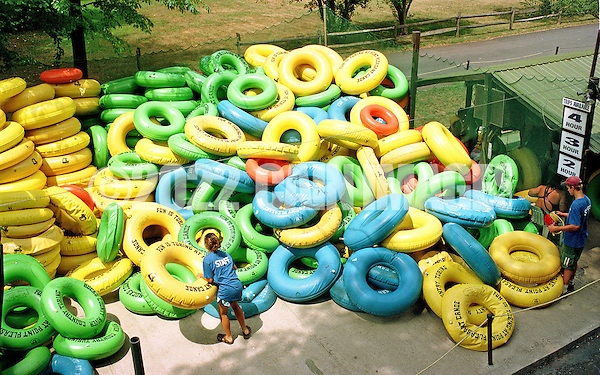 A staff member moves inner tubes back into a pile at Bucks County River Country along the Delaware River in Tinicum, Pennsylvania. (Photo by William Thomas Cain/Cain Images) (William Thomas Cain)