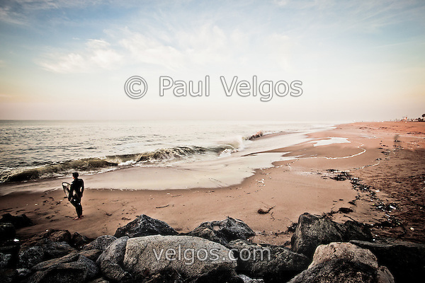 Photo of a surfer at The Wedge in Newport Beach. The Wedge is a famous jetty and surfing spot located along the Pacific Ocean at the end of Balboa Peninsula in Newport Beach in Orange County Southern California. (Photographer: Paul Velgos)