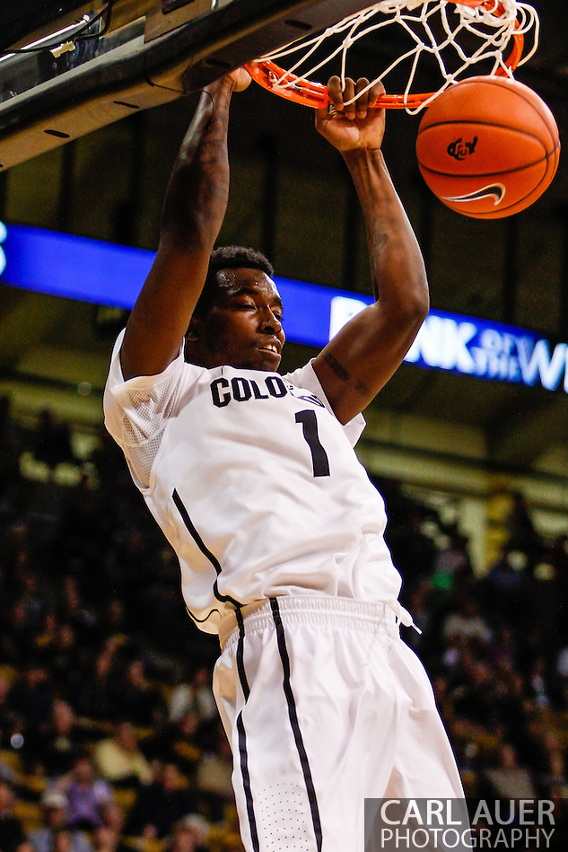 November 16th, 2013:  Colorado Buffaloes redshirt freshman forward Wesley Gordon (1) elevates for a dunk in the second half of the NCAA Basketball game between the Jackson State Tigers and the University of Colorado Buffaloes at the Coors Events Center in Boulder, Colorado (Carl Auer/ZUMAPRESS.com)