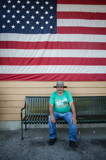 Jose Montrarez waits outside the CalMart in Calistoga (Clark James Mishler)